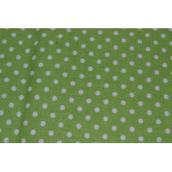 Polka dots on green sold by...